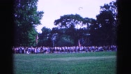 1964: members of school marching band pass observers at patriotic event Stock Footage