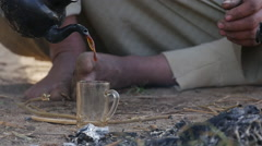 Traditional Egyptian tea cooked on the fire Stock Footage