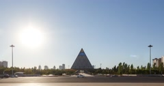 Palace of Peace and Reconciliation at sunset. Zoom. Astana, Kazakhstan. Time Stock Footage