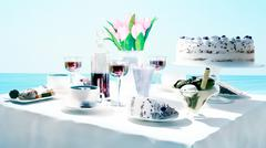 Afternoon tea and delicious dessert on sea background. Stock Illustration