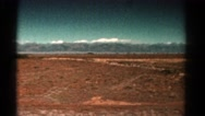 1967: driving open road freedom snow covered mountain long distance background Stock Footage
