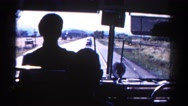 1967: bus driver silhouette view looking forward towards travel destination Stock Footage