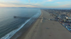 Aerial shot of a scenic beach city and ocean at sunset. Stock Footage
