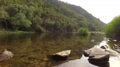 Landscape with calm river with forest mountain rocky shore steady shot 4kp4 Stock Footage