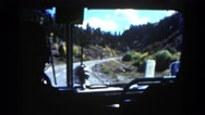 1967: front windshield view of tour bus driving autumn landscape COLORADO Stock Footage