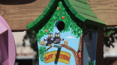 Multicolored wooden birdhouses Stock Footage