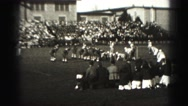 1946: high school football players lineup shifting during game view from stadium Stock Footage