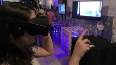 A woman uses virtual reality headset to design the furnitures in her apartment Stock Footage