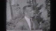 1946: joyful soldier cutting friend's lawn with push mower HARRISBURG Stock Footage