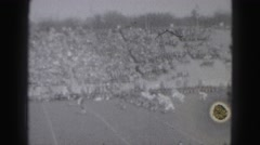 1946: engaging american football match with cheering fans HARRISBURG Stock Footage