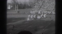 1946: stands filled with fans watching football game HARRISBURG Stock Footage