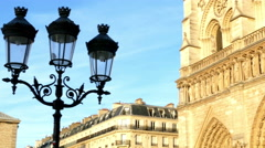 Paris, France: Street lamps and the middle front of Notre Dame Cathedral, with n Stock Footage