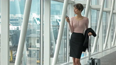 Business woman talking on the phone in the airport terminal Arkistovideo