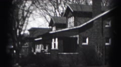 1946: an individual leaving through the back door then out of view. HARRISBURG Stock Footage