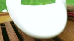 Sprinkling of tea into bowl Stock Footage