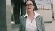 Stylish business woman walking along business centre Stock Footage