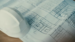 Close-up of blueprints with sketches of projects, helmet Stock Footage