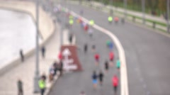 Defocused city marathon runners. Competition concept. 4K background bokeh video Stock Footage