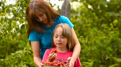 Girl eats strawberry. Stock Footage