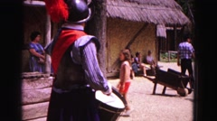 1964: man in costume in front of an amusement park general store JAMESTOWN Stock Footage