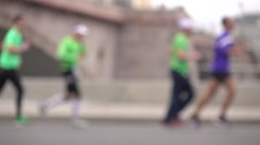 Unrecognizable blurred city marathon runners. Competition concept. Super slow Stock Footage