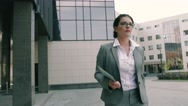 Attractive business woman running to the office Stock Footage