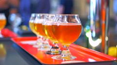4K Flight of Beer, Craft Beer Tasting, Pub Ale Tasting, Background Shot Stock Footage
