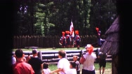 1964: marching at summer camp with flags and many admiring onlookers watching Stock Footage