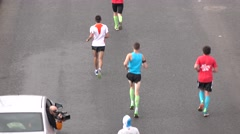 RUSSIA, MOSCOW - SEPTEMBER, 25, 2016. City marathon runners and cameraman Stock Footage