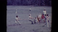 1967: some scholars children playing the classic game of tug of war TUCSON Stock Footage