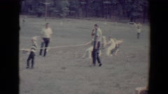 1967: elementary school age girls and boys playing tug of war under supervision Stock Footage