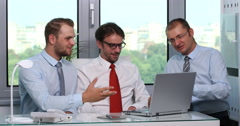 Businessmen Partners Using Laptop Celebration Good Results Handshaking Office Stock Footage