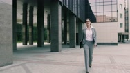 Confident young business woman is sent to the office building documents Stock Footage