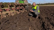 Farmer checking plowed soil Stock Footage