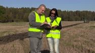 Farmers inspecting plowed field Stock Footage