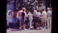 1967: people of different age groups having food outdoor TUCSON, ARIZONA Stock Footage