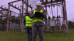 Electrician checking documentation Stock Footage