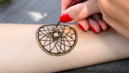 HD 1080 Drawing mehendi Dreamcatcher on a hand close-up Stock Footage