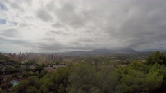 Timelapse of clouds over the mountain in Benidorm Stock Footage