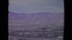 1967: view of an industrial area in vast land with mountain ranges Stock Footage