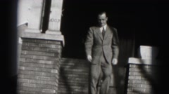 1946: well-dressed man comes out of his home with smile on his face. HARRISBURG Stock Footage