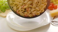 Freshly cooked homemade pasta in cream souce being put on a plate Stock Footage