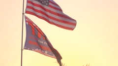Trump Flag and American Flag On Pole Flying at Sunrise Stock Footage