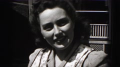 1946: pretty woman with 1940s hairstyle speaks to the camera HARRISBURG Stock Footage