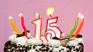 Happy 15 birthday with cake and candles on pink background Stock Footage
