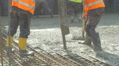 Workers concreting floor by using pipe of  truck mixer pump by Sheyno. Stock Footage