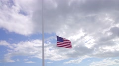 American Flag Being Lowered Down From Flag Pole Stock Footage