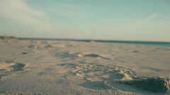 Man muscled legs running on the sand Stock Footage