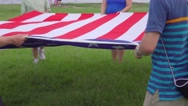 Group of People Folding American Flag Stock Footage