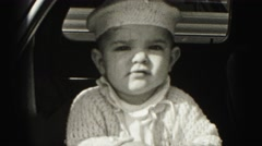 1946: confident baby boy with white macrame homemade knitted hat  Stock Footage